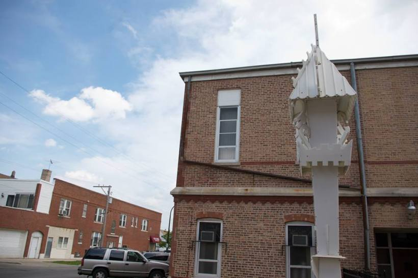 A view of the Lithuanian wayside cross beside St. Anthony's Parish School, Cicero, Illinois.